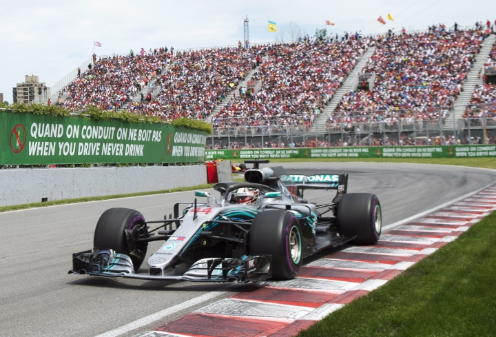 Mercedes driver Lewis Hamilton, of Britain, comes through the Senna corner during the Formula One Canadian Grand Prix auto race in Montreal, Sunday, June 10, 2018, in Montreal. (Ryan Remiorz/The Canadian Press via AP)
