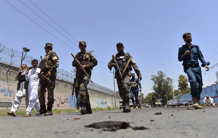 Afghan security personnel arrives at the site of suicide attack in the city of Jalalabad east of Kabul, Afghanistan, Monday, June 11, 2018. A suicide bomber wounded at least 10 civilians when he struck near the education department in the eastern city of Jalalabad. (AP Photo/Mohammad Anwar Danishyar)