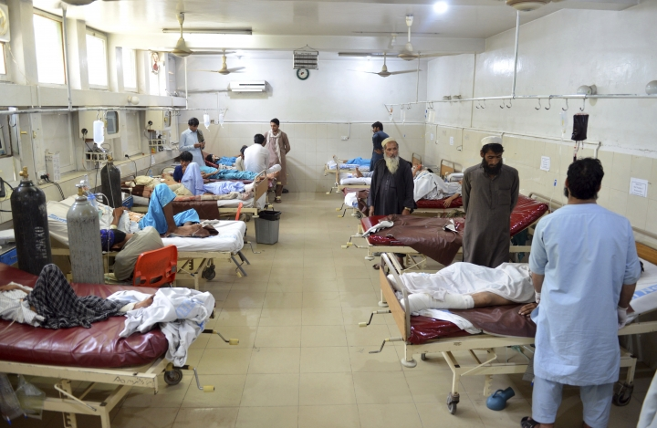 Injured men receive treatment at a hospital following a suicide attack in the city of Jalalabad east of Kabul, Afghanistan, Monday, June 11, 2018. A suicide bomber wounded at least 10 civilians when he struck near the education department in the eastern city of Jalalabad. (AP Photo/Mohammad Anwar Danishyar)
