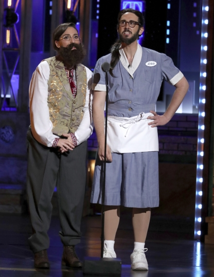 "Co-hosts Sara Bareilles, left, and Josh Groban dress as each other at the 72nd annual Tony Awards at Radio City Music Hall on Sunday, June 10, 2018, in New York. Groban was dressed as Bareilles from ""Waitress,"" and Bareilles was dressed as Groban in ""Natasha, Pierre and the Great Comet of 1812."" (Photo by Michael Zorn/Invision/AP)"