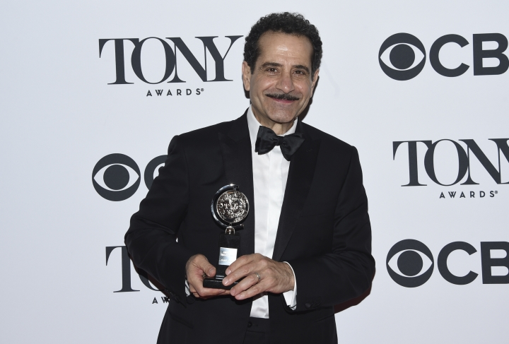 "Tony Shalhoub poses in the press room with the award for leading actor in a musical for ""The Band's Visit"" at the 72nd annual Tony Awards at Radio City Music Hall on Sunday, June 10, 2018, in New York. (Photo by Evan Agostini/Invision/AP)"