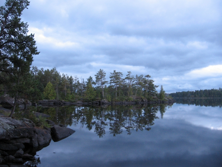 This Sept. 16, 2016 photo shows dusk falling as seen from a campsite on Lake One in Minnesota's Boundary Waters Canoe Area Wilderness. The area's off-the-grid remoteness makes all but the most basic concerns evaporate, leaving nothing to do but soak in the natural beauty. (Giovanna Dell'Orto via AP)