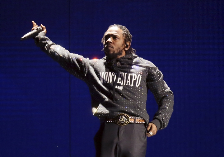 FILE - In this Feb. 21, 2018 file photo, Kendrick Lamar performs at the Brit Awards 2018 in London. Lamar, Lil Wayne and Meek Mill helped the famed Summer Jam music event celebrate its 25th anniversary with jam-packed performances. Remy Ma, Tory Lanez and BBD also worked the stage Sunday for the feverish audience at the MetLife Stadium in East Rutherford, New Jersey. (Photo by Joel C Ryan/Invision/AP, File)