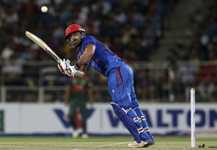 Afghanistan cricket player Samiullah Shinwari plays a shot during the T20 cricket match between Afghanistan and Bangladesh in Dehraduni, India, Friday, June 8, 2018, Afghanistan win the series by 3-0. (AP Photo/Anupam Nath)