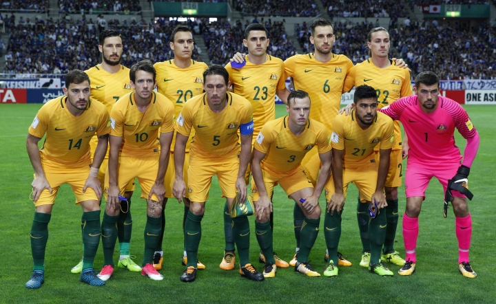 FILE - In this Thursday, Aug. 31, 2017 filer, Australian team pose for a group photo ahead of their World Cup Group B qualifying soccer match against Japan in Saitama, Japan. (AP Photo/Shuji Kajiyama, File)