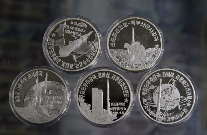 """In this Monday, June 11, 2018, photo coins depicting North Korean rockets program is on display from the collection of rare coin dealer Joseph Poh in Singapore. Stamped with images of """"Eternal President"""" Kim Il Sung, national monuments or ballistic missiles, coins minted in North Korea are renowned among collectors for their scarcity, partly due to international sanctions that outlaw them from being auctioned. (AP Photo/Gemunu Amarasinghe)"""