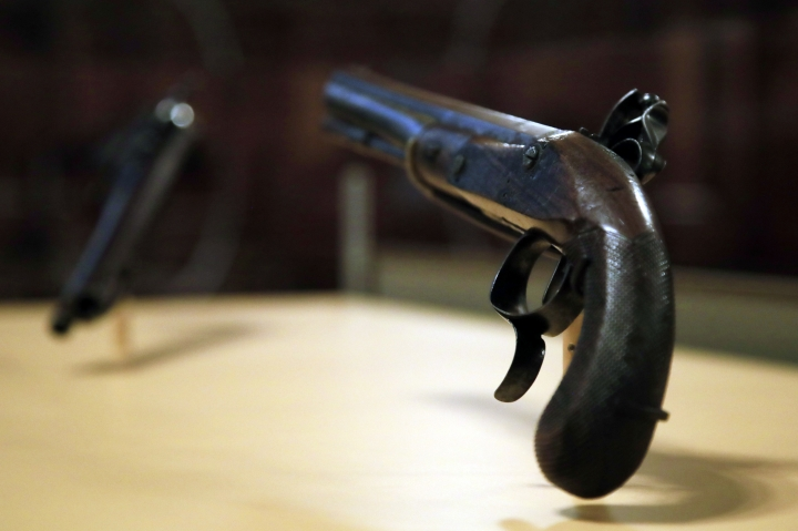 The original flintlock pistols made of walnut, brass and gold that were used in the July 11, 1804 duel with then-Vice President Aaron Burr, which resulted in the death of former secretary of treasury and a retired two-star Army General Alexander Hamilton, are displayed at Smithsonian National Postal Museum in Washington, Monday, June 11, 2018. The blockbuster show Hamilton is finally coming to the nation's capital and the city is preparing in ways that only Washington can. (AP Photo/Manuel Balce Ceneta)