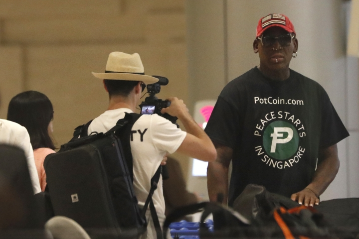 Former NBA basketball player Dennis Rodman arrives at Singapore's Changi Airport on Tuesday, June 12, 2018. (AP Photo/Wong Maye-E)