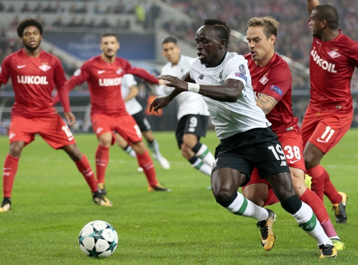 FILE - In this Tuesday, Sept. 26, 2017 file photo, Liverpool's Sadio Mane, front, duels for the ball with Spartak's Andrei Eschenko during the Champions League soccer match between Spartak Moscow and Liverpool in Moscow. Ramadan, the holy month that requires Muslims to fast and refrain from drinking or eating anything from sunrise to sunset, has posed serious challenges for some of the teams in their buildup to the World Cup. The two biggest players from Africa _ Mohamed Salah of Egypt and Liverpool teammate Sadio Mane of Senegal _ are Muslims. (AP Photo/Ivan Sekretarev, File)