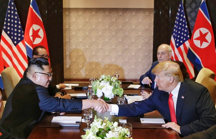 U.S. President Donald Trump shakes hands with North Korean leader Kim Jong Un during their meeting at the Capella resort on Sentosa Island Tuesday, June 12, 2018, in Singapore. (Kevin Lim/The Straits Times via AP)