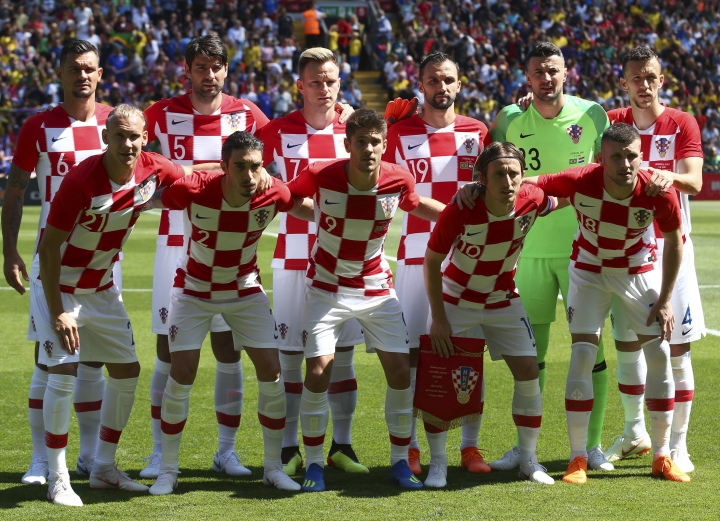 FILE - In this June 3, 2018 photo Croatia team poses for photographers prior to the friendly soccer match between Brazil and Croatia at Anfield Stadium in Liverpool, England. (AP Photo/Dave Thompson, file)