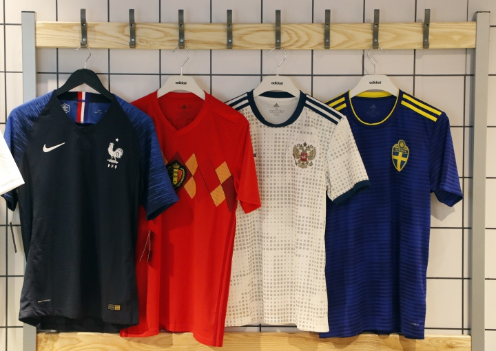 In this June 5, 2018 photo national soccer team jerseys of France, from left, Belgium, Russia and Sweden are on display at a shop in London. With just days to go before the FIFA World Cup, some winners and losers have emerged among the often wild and wacky team jerseys. (AP Photo/Frank Augstein)