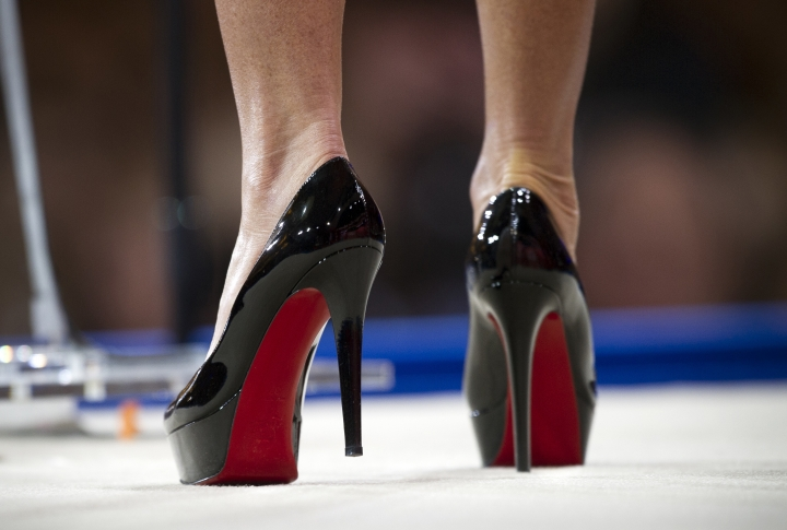 FILE - In this file photo dated Thursday, Feb. 26, 2015, former Alaska Gov. Sarah Palin wears Christian Louboutin shoes while she speaks during the Conservative Political Action Conference (CPAC) in National Harbor, Md., U.S.A.. The European Union's top court has ruled Tuesday June 12, 2018, defending French fashion designer Christian Louboutin's claim to trademark red soled high-heel shoes. (AP Photo/Cliff Owen, FILE)