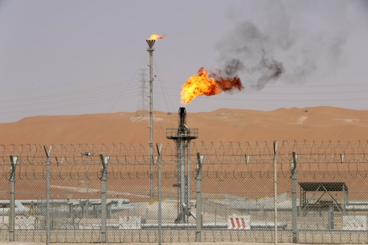 Flames are seen at the production facility of Saudi Aramco's Shaybah oilfield in the Empty Quarter, Saudi Arabia May 22, 2018. Picture taken May 22, 2018. REUTERS/Ahmed Jadallah