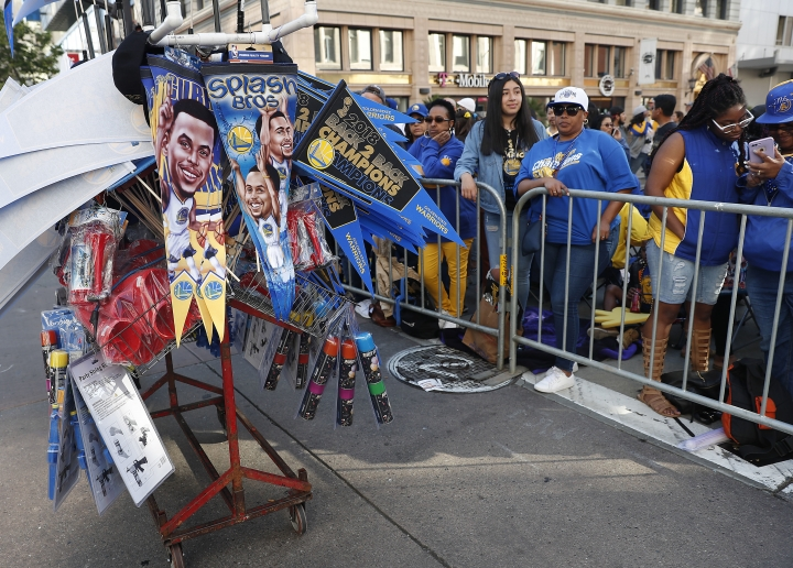 Fans wait for the parade to start in honor of the NBA basketball champion Golden State Warriors, Tuesday, June 12, 2018, in Oakland, Calif.. (AP Photo/Tony Avelar)