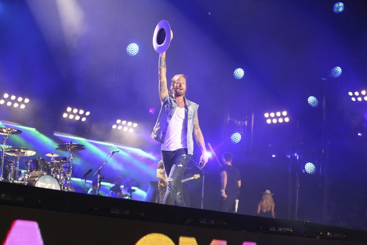 FILE - In this June 10, 2018 file photo, Brian Kelley of Florida Georgia Line performs at the 2018 CMA Music Festival at Nissan Stadium in Nashville, Tenn. (Photo by Laura Roberts/Invision/AP, File)