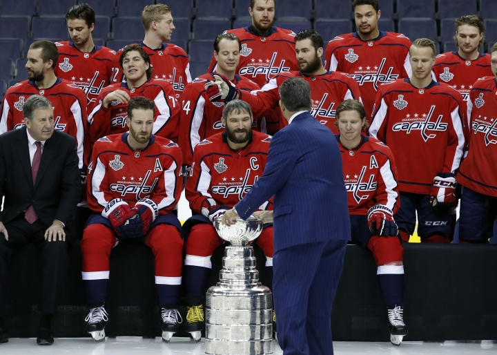 Washington Capitals NHL hockey team owner Ted Leonsis touches the Stanley Cup during the team picture with the Stanley Cup on the ice at Capital One Arena, Tuesday, June 12, 2018, in Washington. (AP Photo/Alex Brandon)