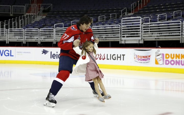 Washington Capitals NHL hockey team right wing T.J. Oshie (77) skates with his daughter Lyla Oshie after the Capitals team picture on the ice at Capital One Arena, Tuesday, June 12, 2018, in Washington. The Stanley Cup-champion Capitals will celebrate the city's first major sports championship in 26 years with a parade down Constitution Avenue this morning. (AP Photo/Alex Brandon)