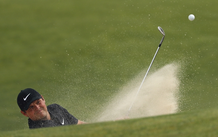 Patrick Reed hits out of a sand trap onto the 16th green during a practice round for the U.S. Open Golf Championship, Monday, June 11, 2018, in Southampton, N.Y. (AP Photo/Julie Jacobson)