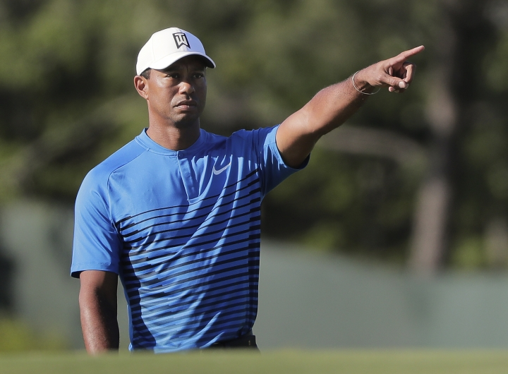 Tiger Woods motions while chipping onto the third green during a practice round for the U.S. Open Golf Championship, Tuesday, June 12, 2018, in Southampton, N.Y. (AP Photo/Julie Jacobson)