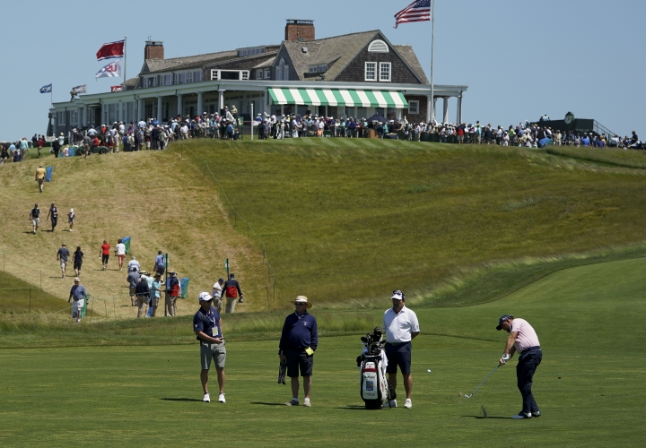 Graeme McDowell, of Northern Ireland, hits off the first fairway during a practice round for the U.S. Open Golf Championship, Tuesday, June 12, 2018, in Southampton, N.Y. (AP Photo/Carolyn Kaster)