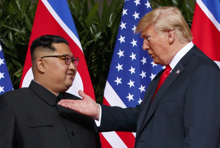 """FILE - In this June 12, 2018, file photo, U.S. President Donald Trump, right, meets with North Korean leader Kim Jong Un on Sentosa Island in Singapore. As soon as Kim steps off the airplane China provided him for the Singapore trip, Beijing will be mindful of maintaining its influence over a Pyongyang that may feel less isolated after Trump showered Kim with praises, called him a """"very talented man,"""" and made security concessions in return for very little. (AP Photo/Evan Vucci, File)"""
