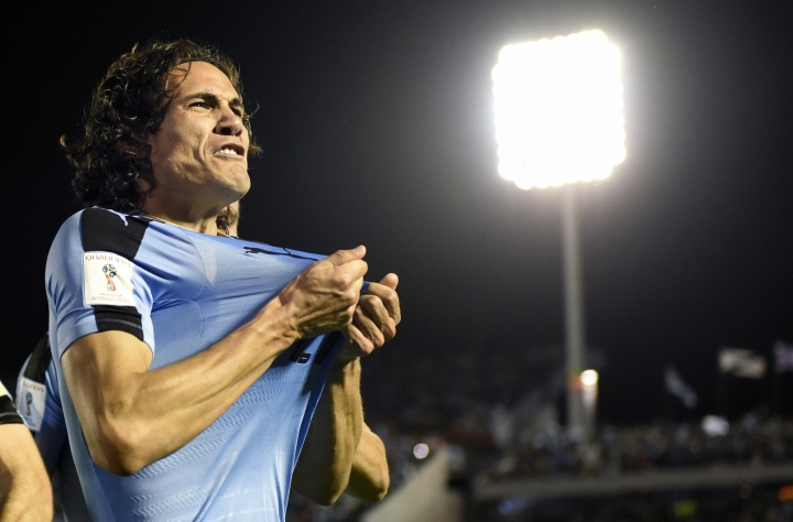 FILE - In this Tuesday, Oct. 10, 2017 filer, Uruguay's Edinson Cavani celebrates after scoring against Bolivia during a 2018 World Cup qualifying soccer match in Montevideo, Uruguay. (AP Photo/Matilde Campodonico, File)