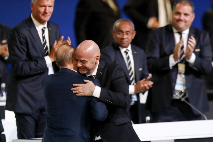 FIFA President Gianni Infantino, right, hugs Russian President Vladimir Putin at the FIFA congress on the eve of the opener of the 2018 soccer World Cup in Moscow, Russia, Wednesday, June 13, 2018. The congress in Moscow is set to choose the host or hosts for the 2026 World Cup. (AP Photo/Pavel Golovkin)
