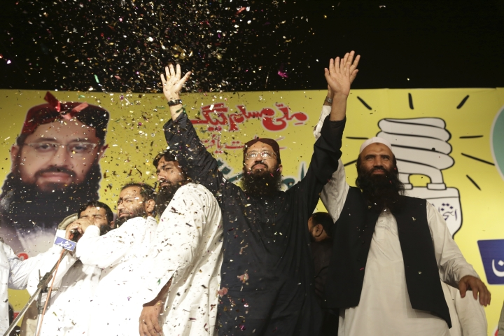 FILE - In this Thursday, Sept. 14, 2017 file photo, Sheikh Yaqub, center, candidate of the newly-formed Milli Muslim League party, waves to his supporters at an election rally in Lahore, Pakistan. The Election Commission blocks the way of Milli Muslim League party to take part in the July 25 vote when people will elect members of the National Assembly and four provincial legislatures. (AP Photo/K.M. Chaudary, file)