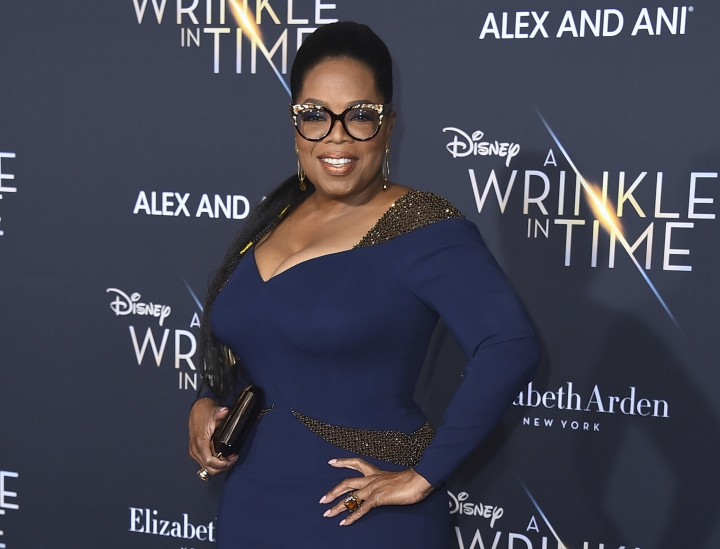 "FILE - In this Feb. 26, 2018 file photo, Oprah Winfrey arrives at the world premiere of ""A Wrinkle in Time"" in Los Angeles. Winfrey will serve as godmother of a new Holland America ship called the Nieuw Statendam. She will join a Jan. 30 three-day ""Girls' Getaway"" on the cruise line's new ship from Fort Lauderdale, Fla. Passengers may attend one of three live ""Conversations with Oprah"" onboard. (Photo by Jordan Strauss/Invision/AP, File)"