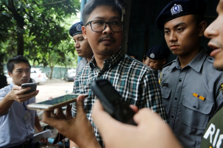 Detained Reuters journalist Wa Lone talk to reporters while leaving the court hearing in Yangon, Myanmar June 12, 2018. REUTERS/Ann Wang