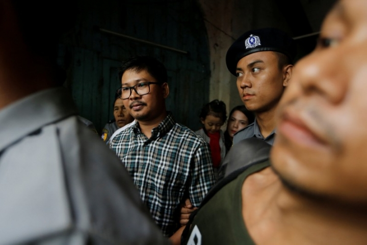 Detained Reuters journalist Wa Lone escort by police while leaving the court hearing in Yangon, Myanmar June 12, 2018. REUTERS/Ann Wang