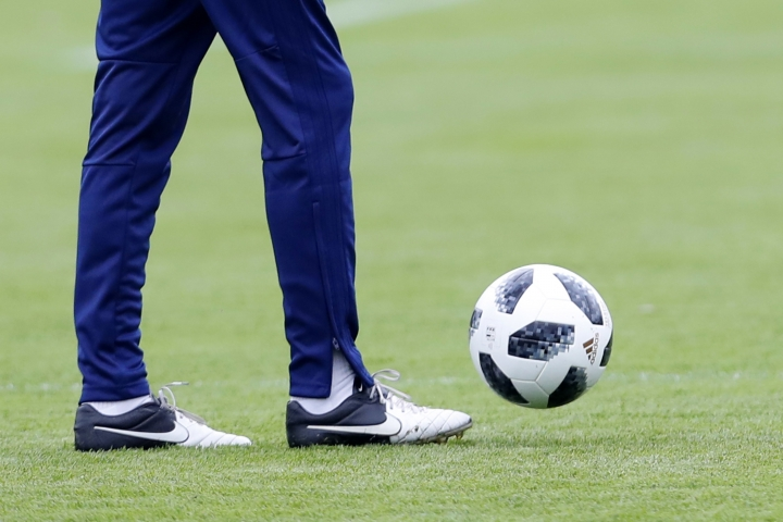 Iran's national football team Head coach Carlos Queiroz controls the ball during a training session of Iran at the 2018 soccer World Cup in Moscow, Russia, Tuesday, June 12, 2018. With just days until their opening match against Morocco, the Iranian players are scrambling to settle their footwear situation after Nike, which had previously supplied the team with boots, said it would not do so for this tournament because of global economic sanctions against the Asian country. (AP Photo/Hassan Ammar)