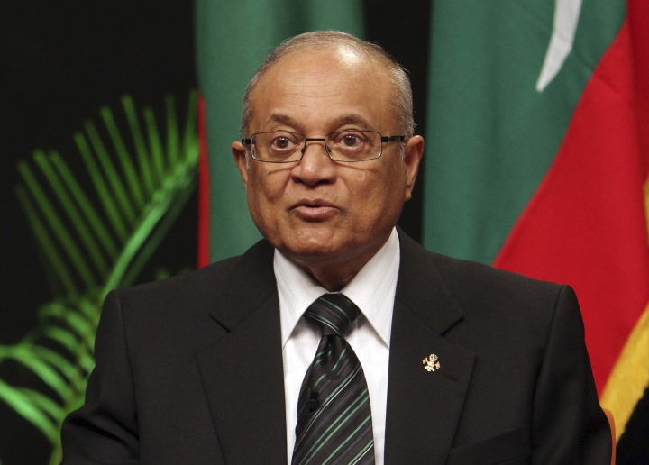 FILE - In this Monday, Sept. 5, 2011, file photo, Maldives former President Maumoon Abdul Gayoom addresses a press conference to announce the formation of a new political party in Male, Maldives. A Maldives court has sentenced Gayoom accused of plotting to overthrow the government to 19 months in prison for failing to corporate with the police investigation. (AP Photo/Sinan Hussain, File)