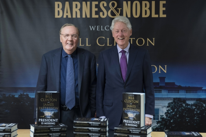 "FILE - In this June 5, 2018 file photo, former President Bill Clinton, right, and author James Patterson pose for photographers during an event to promote their new novel, ""The President is Missing,"" in New York. Clinton's debut as a novelist is already one of the year's biggest hits. ""The President is Missing,"" the thriller he co-wrote with James Patterson, sold 250,000 copies its first week. Alfred A. Knopf and Little, Brown and Co., the book's co-publishers, announced Wednesday, June 13 that the number includes hardcover, e-book and audio sales. (AP Photo/Mary Altaffer, File)"