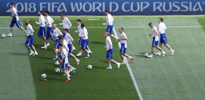 Russian soccer team train during the official training session of the Russian team one the eve of the group A match between Russia and Saudi Arabia at the 2018 soccer World Cup at Luzhniki stadium in Moscow, Russia, Wednesday, June 13, 2018. (AP Photo/Hassan Ammar)