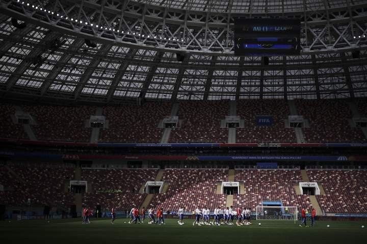 The Russian soccer team warm-up during the official training session on the eve of the group A match between Russia and Saudi Arabia at the 2018 soccer World Cup at Luzhniki stadium in Moscow, Russia, Wednesday, June 13, 2018. (AP Photo/Felipe Dana)