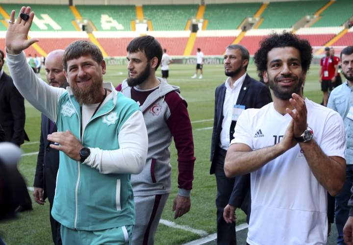 FILE - In this photo taken on Sunday, June 10, 2018, Egyptian national soccer team player and Liverpool's star striker Mohammed Salah, right, and Chechen regional leader Ramzan Kadyrov, greets soccer fans as they arrive to attend the Egypt national soccer team training session in Grozny, Russia. (AP Photo)