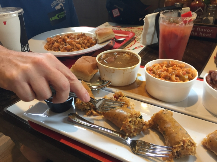 This June 4, 2018 photo shows boudin sausage, crawfish etouffee and other Cajun-style food served at a cafe on Avery Island, Louisiana, as part of a complex of attractions connected to the production of Tabasco. Tabasco was first made in 1868 and celebrates its 150th year this year. Visitors can see exhibits about the history of the famous pepper sauce, view the factory production, enjoy free tastings and samples, shop and also tour a nature preserve called Jungle Gardens. (AP Photo/Beth J. Harpaz)