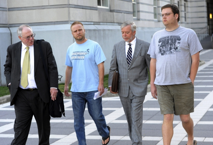 FILE - In this undated file photo, David Nicoll, center left, 39, of Mountain Lakes, N.J., president of Biodiagnostic laboratory Services, and employee and brother Scott Nicoll, right, 32, of Wayne, N.J., leave Federal Court in Newark, N.J., with representatives after being arrested in 2013 and pleaded guilty to conspiracy and money laundering through their New Jersey company. The brothers are scheduled to appear before a federal judge in Newark, facing sentencing on Wednesday, June 13, 2018. (Tyson Trish/The Record via AP, File)