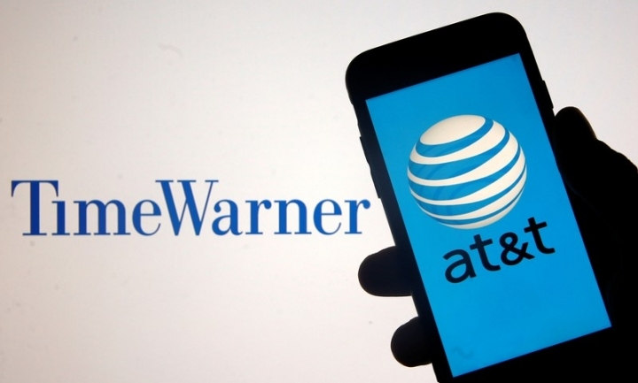 Smartphone with AT&T logo is seen in front of displayed Time Warner logo in this picture illustration taken June 13, 2018. REUTERS/Dado Ruvic/Illustration