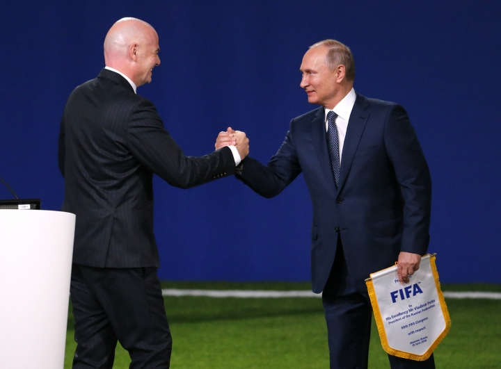 FIFA President Gianni Infantino, left, greets Russian President Vladimir Putin at the FIFA congress on the eve of the opener of the 2018 soccer World Cup in Moscow, Russia, Wednesday, June 13, 2018. The congress in Moscow is set to choose the host or hosts for the 2026 World Cup. (AP Photo/Alexander Zemlianichenko)