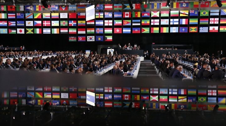 Delegates attend the FIFA congress on the eve of the opener of the 2018 soccer World Cup in Moscow, Russia, Wednesday, June 13, 2018. The congress in Moscow is set to choose the host or hosts for the 2026 World Cup. (AP Photo/Alexander Zemlianichenko)