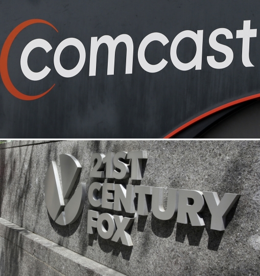 FILE- This combo of file photos shows the 21st Century Fox sign outside of the News Corporation headquarters building on Aug. 1, 2017, in New York, bottom, and a Comcast sign on Oct. 12, 2017, in Hialeah, Fla. Comcast is making a $65 billion bid for Fox's entertainment businesses, setting up a battle with Disney to become the next mega-media company. (AP Photo/File)