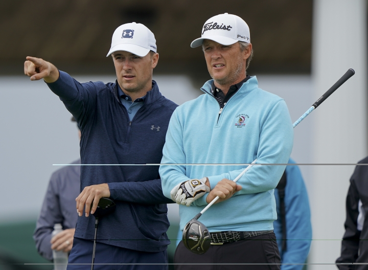 Jordan Spieth, left, talks with Matt Jones, of Australia during a practice round for the U.S. Open Golf Championship, Wednesday, June 13, 2018, in Southampton, N.Y. (AP Photo/Carolyn Kaster)