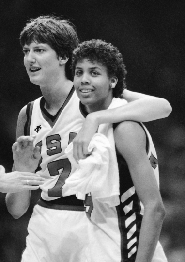 FILE - In this August 1984 file photo, United States' Anne Donovan, left, and Cheryl Miller celebrating the team's victory over Canada in women's basketball at the Olympics in Los Angeles. Donovan, the Basketball Hall of Famer who won a national championship at Old Dominion, two Olympic gold medals in the 1980s and coached the U.S. to gold in 2008, died Wednesday, June 13, 2018, of heart failure. She was 56. Donovan's family confirmed the death in a statement. (AP Photo/Ray Stubblebine, File)