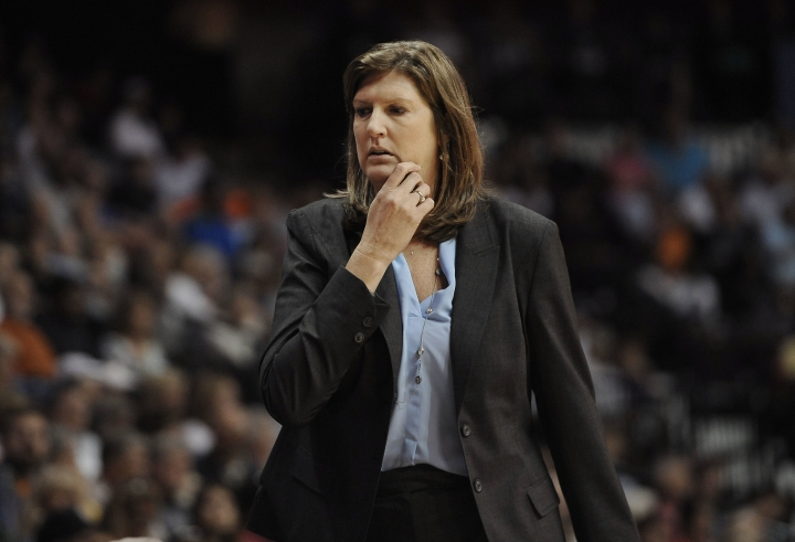 FILE - In this July 31, 2015, file photo. Connecticut Sun coach Anne Donovan watches her players in a WNBA basketball game against the Seattle Storm in Uncasville, Conn. Donovan, the Basketball Hall of Famer who won a national championship at Old Dominion, two Olympic gold medals in the 1980s and coached the U.S. to gold in 2008, died Wednesday, June 13, 2018, of heart failure. She was 56. Donovan's family confirmed the death in a statement. (AP Photo/Jessica Hill, File)
