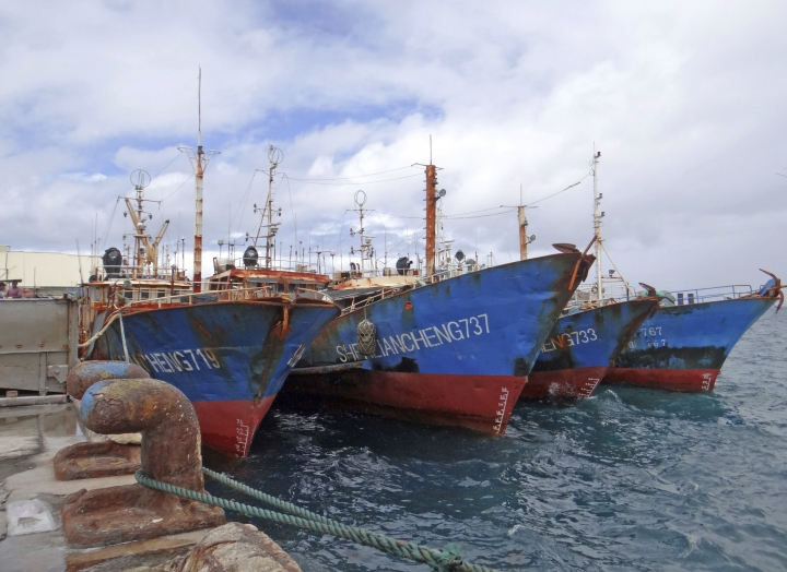 Luen Thai Fishing Venture boats are docked at the Majuro port in the Marshall Islands on Feb. 1, 2018. Luen Thai is one of the companies that was supplying fish that entered the supply chain of Sea To Table. Men work around the clock, getting little pay. (AP Photo/Hilary Hosia)