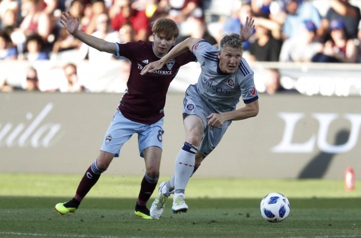 Chicago Fire midfielder Bastian Schweinsteiger, front, drives past Colorado Rapids midfielder Johan Blomberg during the first half of an MLS soccer match Wednesday, June 13, 2018, in Commerce City, Colo. (AP Photo/David Zalubowski)