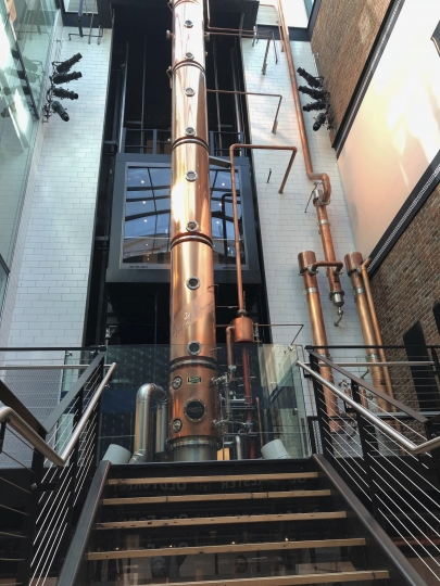 This Thursday, June 7, 2018, photo, shows the copper column still at Old Forester Distilling Co. in downtown Louisville, Ky. Old Forester, the bourbon that launched a family dynasty and a spirits company, has returned to its pre-Prohibition Kentucky home in a newly renovated building that symbolizes the brand's comeback. (AP Photo/Bruce Schreiner)